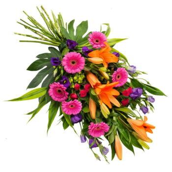 Een indrukwekkend rouwboeket in felle kleuren. Dit bevat doorgaans bloemen zoals lelies, mini-gerbera's, lisianthus, rozen, hertshooi en seizoensgroen.