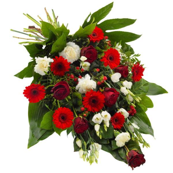 """Handgemaakt rouwboeket in rode en witte tinten, afgewerkt met seizoensgroen. Bevat bloemen zoals rozen, anjers eustoma en meer. De afbeelding toont de """"grote"""" variant. Een rouwlint kan afzonderlijk worden bijgevoegd."""